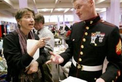 Amy Hagopian, co-chairwoman of the Garfield High PTSA, lights up Marine Sgt. Christopher Matthews in the school lunchroom. Hagopian is trying to get military recruiters barred from the school. The Marines and the Army have failed to meet recruiting quotas in recent months. Photo: Dan DeLong/Seattle Post-Intelligencer / SL.